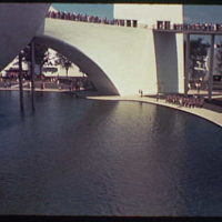 World's Fair. View of Theme Center lagoon, trylon and perisphere, and helicline