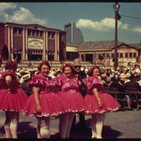World's Fair. Women in costume near George Jessel's Knickerbocker Inn with National Cash Register Building in far background