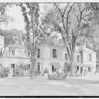 Charles E. Kock, residence on Stanwich Rd., Greenwich, Connecticut. Rear facade from left