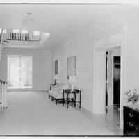 Charles S. Davis, residence at 850 Lake Trail, Palm Beach, Florida. Stair hall, to loggia