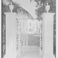 Charles S. Davis, residence in Palm Beach, Florida. Lake facade through Lake Trail gate, open