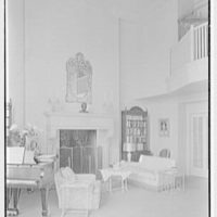 Ellen Ballon, residence at 2 W. 67th St., New York City. Living room fireplace and piano, vertical