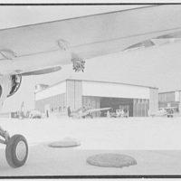 Grumman Aircraft Engineering Corp., Bethpage, Long Island. General exterior, under plane wing