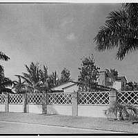 H.T. Morgan, residence at 31 LaGorce Cir., Miami Beach, Florida. Roofs over Brevity Lane fence
