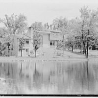 James H. Hansen, residence in Redding, Connecticut. House reflected in lake I