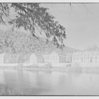 Kent School, Kent, Connecticut. North dormitory, library and auditorium from across river