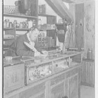 Mrs. Lawrence J. Ullman, Heritage House, business on Prospect Ave., Tarrytown, New York. Mr. Bean at his account book