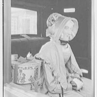 Mrs. Lawrence J. Ullman, Heritage House, business on Prospect Ave., Tarrytown, New York. Detail of equipage woman figure
