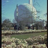World's Fair. View across flowers toward Theme Center