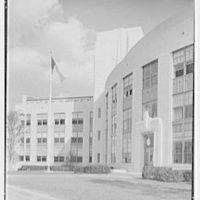 Cardinal Hayes Memorial High School, Grand Concourse, Bronx, New York. Vertical detail, flag and tower from right
