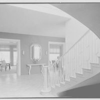 Caryll Tucker, residence in Hobe Sound, Florida. Stair hall, to dining room and living room