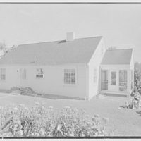 D.S. Schaab, residence in Pearl River, New York. Rear facade, with family group