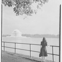 Jefferson Memorial, Washington, D.C. View from walk across the basin with girl