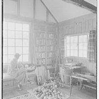 Miss Ruth Thompson, residence on Parsonage Rd., Greenwich, Connecticut. Living room, Miss Thompson and gourds