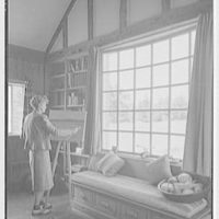 Miss Ruth Thompson, residence on Parsonage Rd., Greenwich, Connecticut. Living room, Miss Thompson at easel