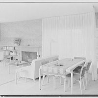 Robert Glassford, residence in Hobe Sound, Florida. Living room dining table and drawn curtain