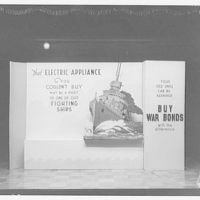 Electric Institute of Washington, Potomac Electric Power Co. building. Display urging people to keep their old appliances and buy war bonds instead