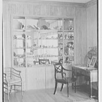 Mrs. Worthington Scranton, residence in Hobe Sound, Florida. Living room, from shell collection corner