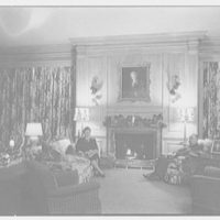Robert M. Hillas, Indian Harbor, residence in Greenwich, Connecticut. Library fireplace with Mr. and Mrs. Hillas