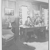 Gypsy Rose Lee, residence at 153 E. 63rd St., New York City. Herself at library desk