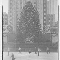Rockefeller Center. Christmas tree and skaters, from left