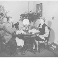 Ed and Pegeen Fitzgerald, residence at 15 E. 36th St., New York City. Ed, Pegeen and cat broadcasting at breakfast