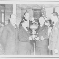Eggers & Higgins, 542 5th Ave., New York City. Copy of Mr. Higgins, receiving silver cup