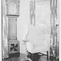 Mr. and Mrs. T. Ferdinand Wilcox, residence on Smith Ridge Rd., New Canaan, Connecticut. Living room, chair and clock