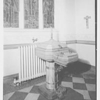 Our Lady of Mercy Church, 2500 Marion Ave., Bronx, New York. Baptismal font, closed