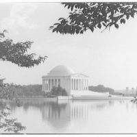 Jefferson Memorial. Front and left of Jefferson Memorial through trees from across water