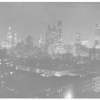 Mrs. Christopher J. Mileham, residence at 350 E. 57th St., New York City. Night view from outside library window