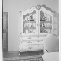 Mr. and Mrs. Theron Catlin, residence at 41 W. Brentmoor Park, Saint Louis, Missouri. Dining room, view to glass cabinet