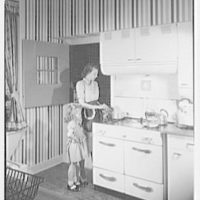 Walter P. Wood, residence at 814 E. Gum St., Evansville, Indiana. Kitchen, with Mrs. Wood