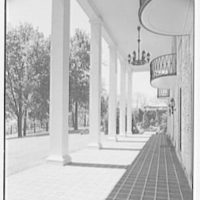 Cornelius V. Whitney, residence in Old Westbury, Long Island, New York. Looking out through portico