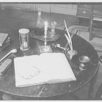 Mrs. Lawrence J. Ullman, business in Tarrytown, New York. Round table and doctor's log, horizontal