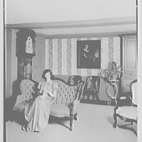 Gilbert house, residence in Sturrowtown, Massachusetts. Living room sofa, with figure