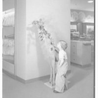 Lord & Taylor, business in Millburn, New Jersey. Boy and giraffe