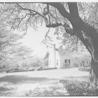 Mr. and Mrs. Clarkson Potter, residence in Old Brookville, Long Island, New York. View to schoolhouse I