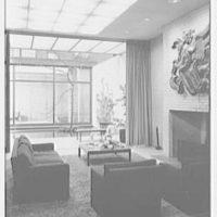 John D. Rockefeller III, residence at 252 E. 52nd St., New York City. Glass doors open, living room to bedroom