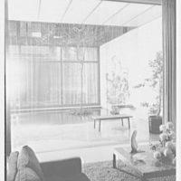John D. Rockefeller III, residence at 252 E. 52nd St., New York City. Glass doors open, with rain