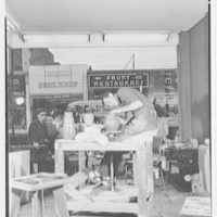 Perman Brothers, business in Hempstead, Long Island, New York. View to street showing man at potter's wheel