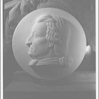 Statues and sculpture over the door of the gallery of House chamber, U.S. Capitol. George Mason medallion II