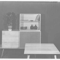 Berge-Norman Associates, business at 45 E. 28th St., New York City. Square table
