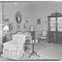 Charles E. Dunlap, residence at 102 E. 73rd St., New York City. Living room sofa and paintings