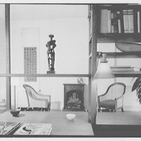Mr. Ward Bennett, residence at 228 E. 71st St., New York City. View toward bookcase and fireplace