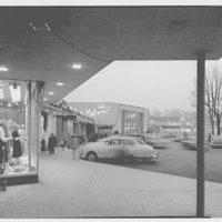 Shopping center, Great Neck, Long Island, New York. Long shot under canopy