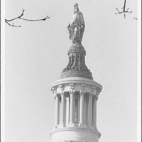 U.S. Capitol exteriors. Statue of Freedom from telephoto II
