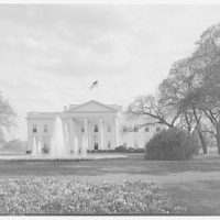 White House exteriors. View of White House across lawn with fountain II