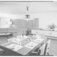 Mr. and Mrs. Gustav Jaff, residence on Atkinson Rd., Rockville Centre. Dining room, table to couches