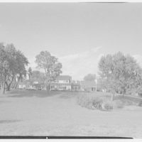 Mr. and Mrs. Paul Mellon, residence in Upperville, Virginia. Entire east facade from distant hill